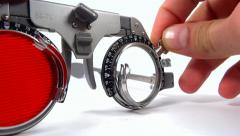 close up spectacles used for eyesight tests with red filter lens testing - stock footage