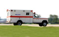 Ambulance driving fast Stock Photos