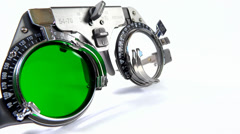 Spectacles used for eyesight tests with various lenses and green filter lens Stock Footage