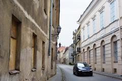 Modern car in narrow paved street Stock Photos