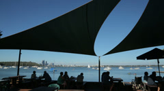 Silhouette of people in cafe in park, matilda bay, perth, australia Stock Footage