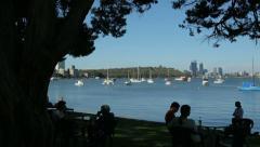 Pan of people in park, matilda bay, perth, australia Stock Footage
