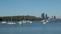Pan of perth skyline and matilda bay, australia Stock Footage