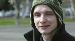 Young man smiles on camera Stock Footage