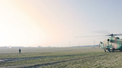 Russian Military Helicopter in the field. Stock Footage
