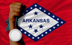 Silver medal for sport and  flag of american state of arkansas Stock Photos