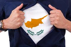young sport fan opening his shirt and showing the flag his country cyprus - stock illustration
