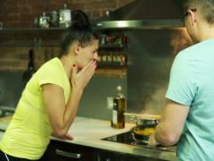 Woman tasting her boyfriend dish and splitting it up Stock Footage