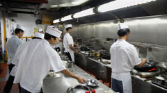 Chefs of a restaurant kitchen ,Xi'an city, Shaanxi province, China Stock Footage