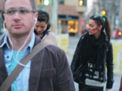 People walking along the street and listening an mp3 player Stock Footage