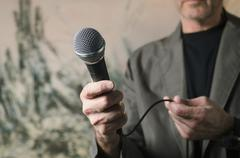 man pointing microphone - stock photo