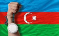 Stock Photo of silver medal for sport and  national flag of azerbaijan