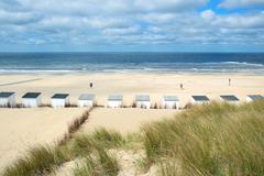 blue beach huts at texel - stock photo