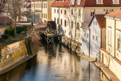Old watermill on chertovka river in prague. Stock Photos