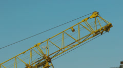 Close up of a crane carrying a load. op of crane at construction site. Stock Footage