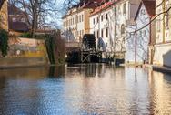 Stock Photo of old watermill on chertovka river in prague.