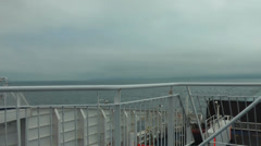 Coast with low cloud from deck of ship Stock Footage