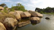 AERIAL: Low flight over rocks and river in Sri Lanka Stock Footage