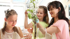Family with children hang easter egg. Stock Footage