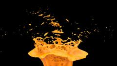 orange color splash in slow motion, isolated on black (FULL HD) - stock footage