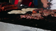 Stock Video Footage of Pork meat, sausages on grill, barbecue, tortilla, frying, street vendors, fair