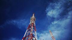 Birds Swarming Radio Cellular Tower Stock Footage