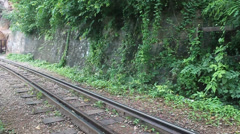 Train rides on Burma railway Stock Footage