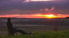 6K (!!!) & 4K & HD, 14-bit RAW OUTPUT, Man sitting by sunset, time lapse Stock Footage
