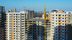 Timelapse of building under construction. Crane lifts the cement on the construc - stock footage