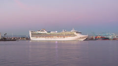 Cruise Ship Leaves Port At Sunset Stock Footage