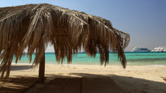 Straw beach umbrellas at a tropical resort Stock Footage