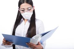 woman wearing a protective mask with - stock photo