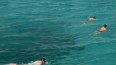 Group of people swimming on the open sea Stock Footage