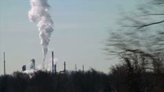 1105 Driving by Factory with Smoke Stakes Releasing Smoke, Slow Motion  Stock Footage