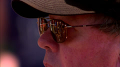 WINDSOR, UK, 27TH SEPTEMBER 2009: Man watching race with reflection in glasses Stock Footage