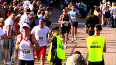 WINDSOR, UK, 27TH SEPTEMBER 2009: Military volunteers assist runners in Marathon - stock footage