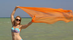 Woman with pareo waving in the wind Stock Footage