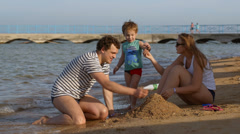 Family making a sandcastle Stock Footage