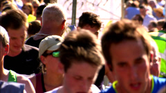 WINDSOR, UK, 27TH SEPTEMBER 2009: Jubilant older runner finishes marathon Stock Footage