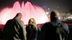 People watching a fountains show at night Stock Footage