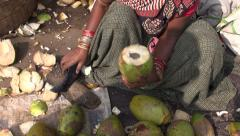 Peeling coconut with edge knife of  india Tamilnadu market Stock Footage