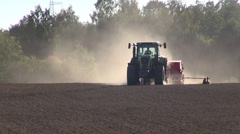 Tractor seeding grain crop on  field Stock Footage
