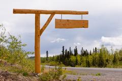 Maaseudun maan tie ajotie puinen allekirjoittaa hallituksen Kuvituskuvat