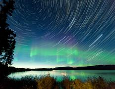startrails northern lights display lake laberge - stock photo