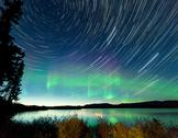 Stock Photo of startrails northern lights display lake laberge