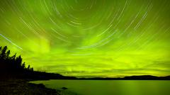 startrails northern lights show over lake laberge - stock photo