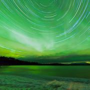 aurora borealis startrails frozen lake laberge - stock photo