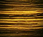 Stock Photo of blurred golden colored striped pattern