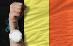 Stock Photo of silver medal for sport and  national flag of belgium