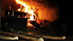 Wood fire in the oven and meat pita Stock Footage